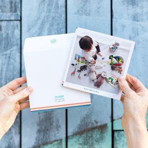 small square softcover photo album